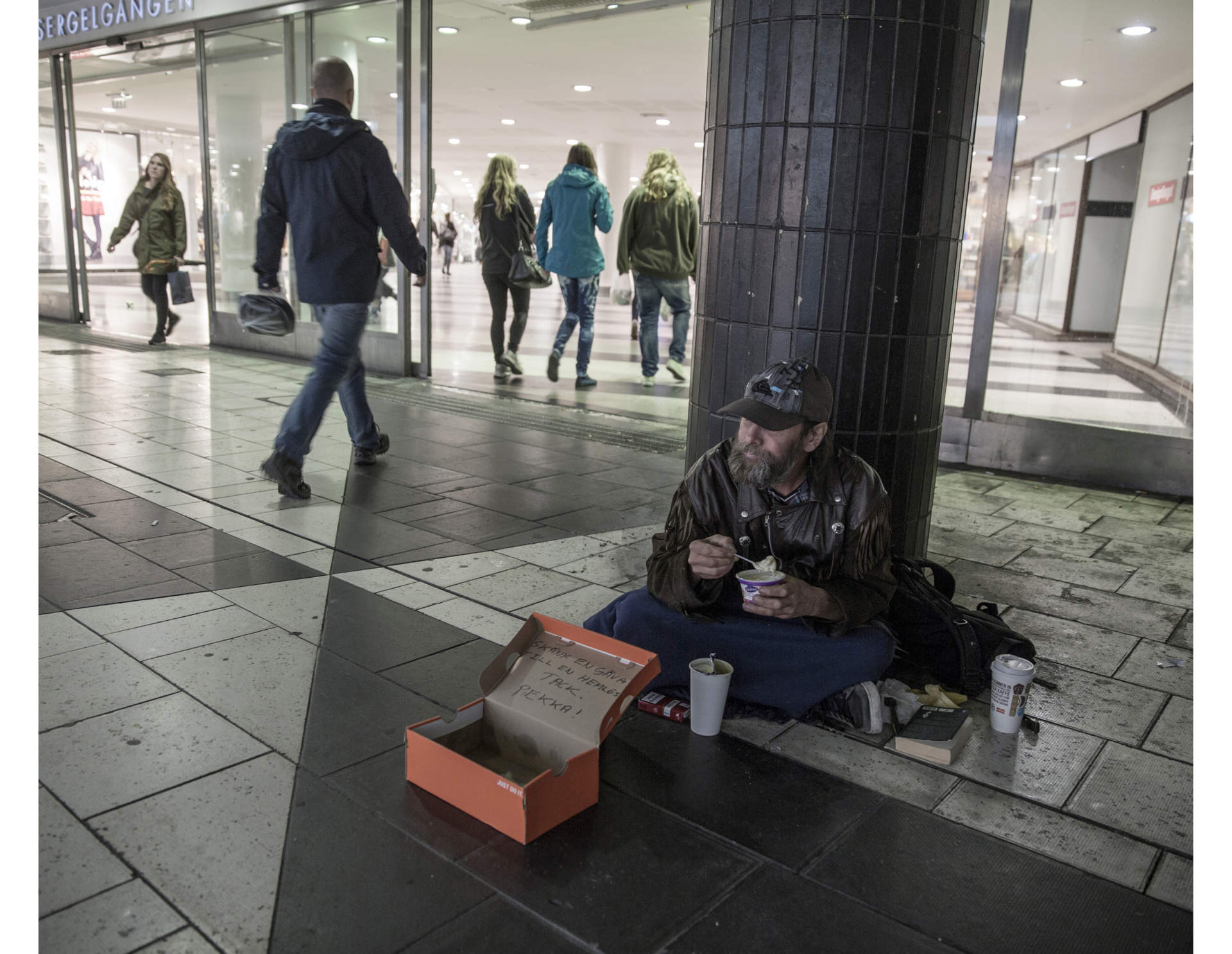 Pekka begs for money at his favourite spot in central Stockholm. The money he gets, he spends on Cigarettes and beer.